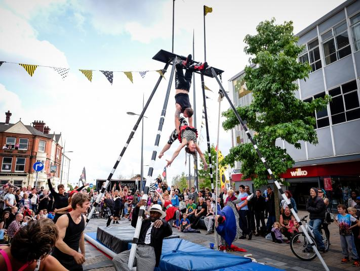 circus artists perform in public space