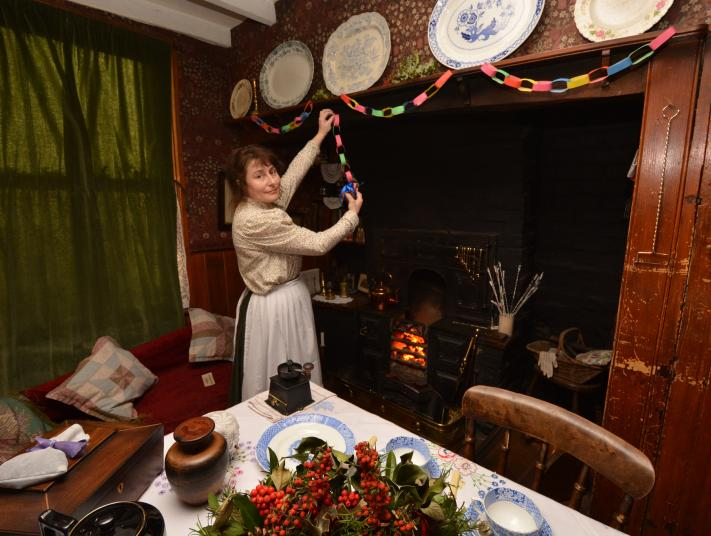 A worker at Black Country Living Museum puts up paper chains.