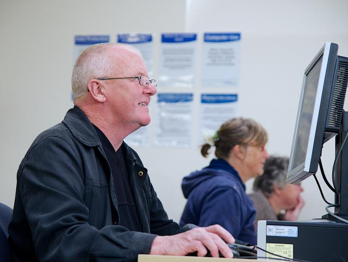 A man uses a computer