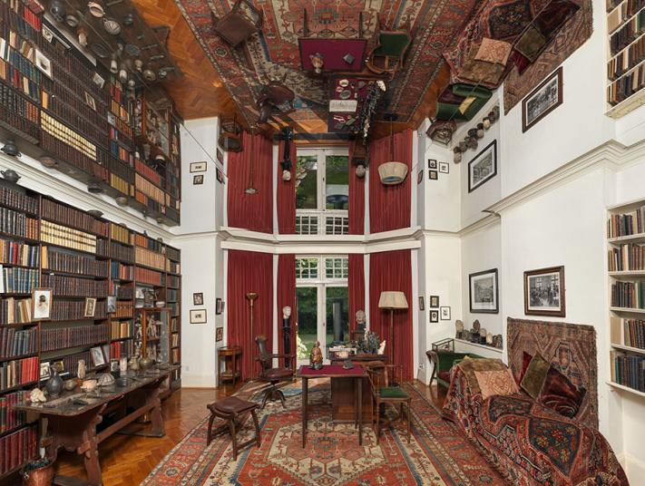Internal view of Freud's study with giant mirror across the ceiling.