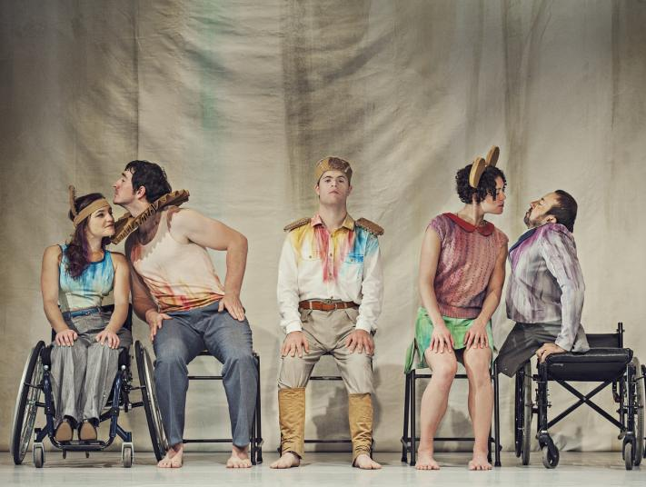 Five performers with disabilities pose for a promotional photograph