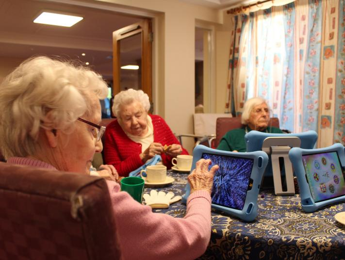 A group of older women use iPads at Imagine, arts and older people's programme at City Arts Nottingham.