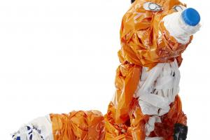 An orange fox, made from recycled plastic