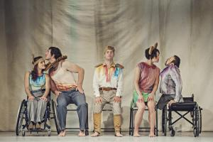 Five performers with disabilities pose for a promotional image of Stopgap Dance Company.