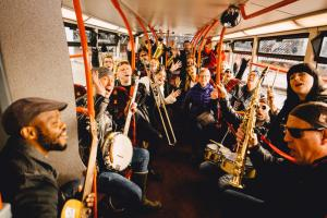 People on bus with musicians