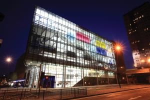 The exterior of Newcastle City Library at night.