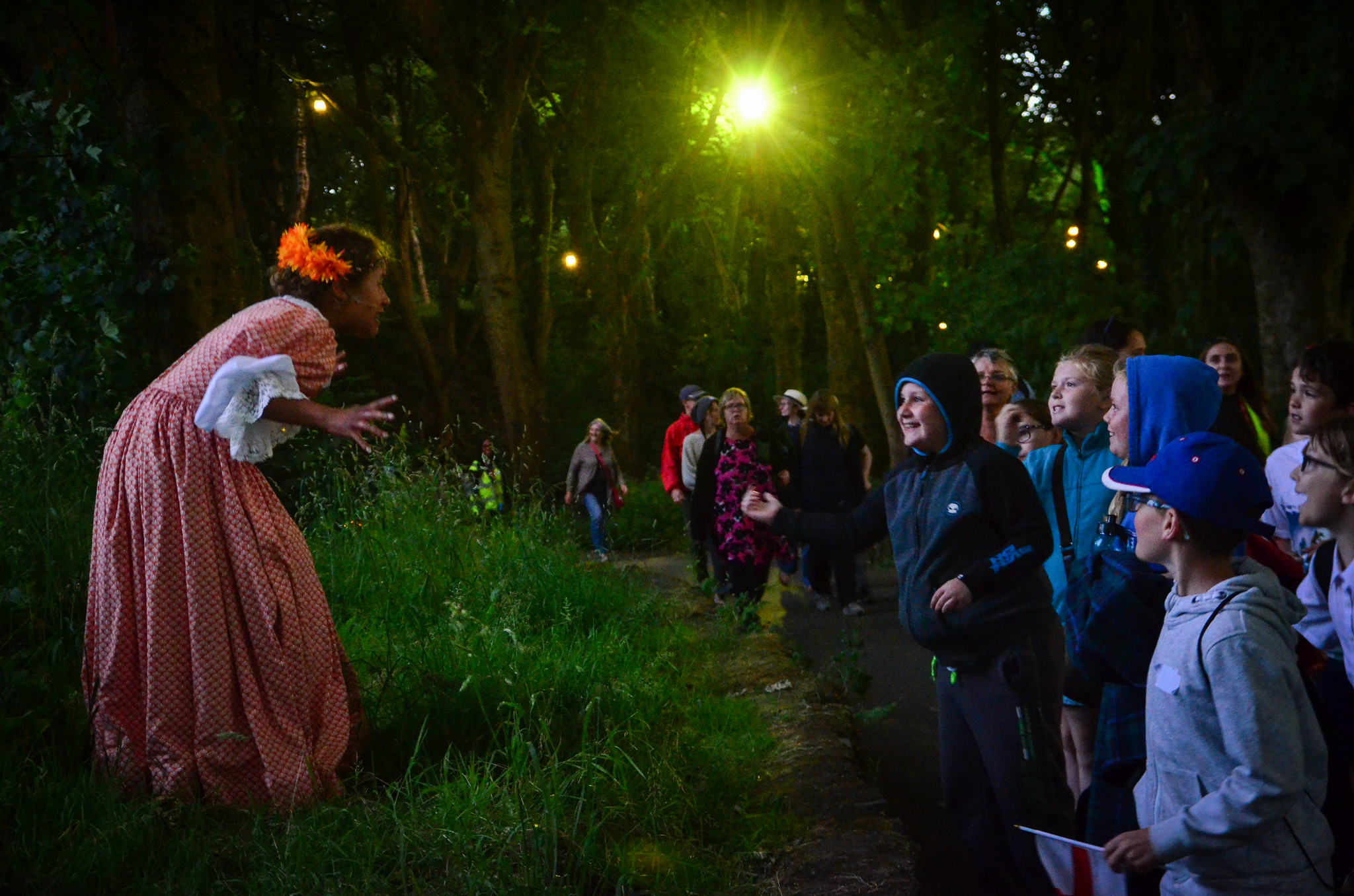 Constance (Nisa Cole) asks the audience's help as they wander through the Williamson Park woods