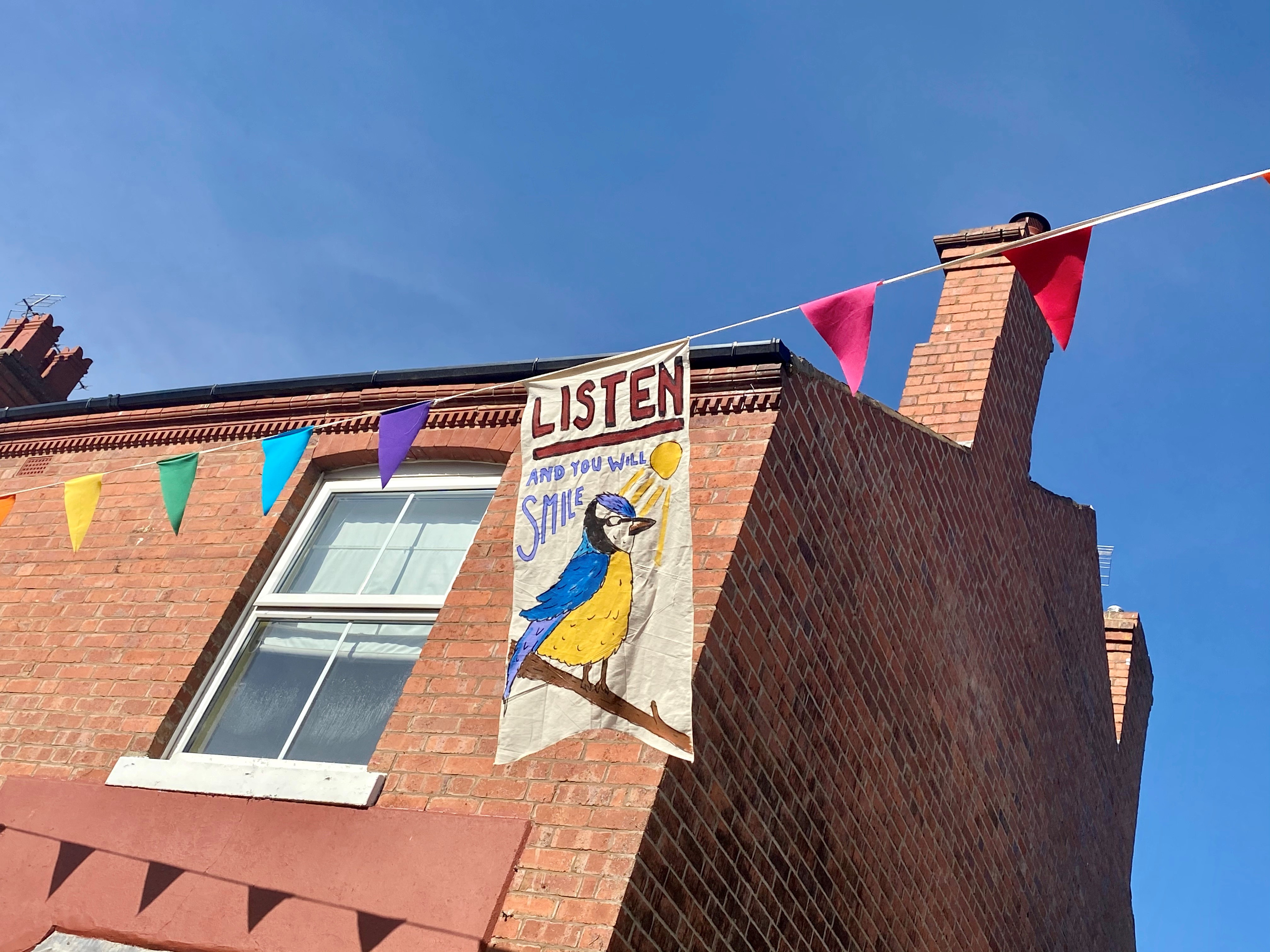 Banner which says Listen and you will Smile with a blue bird