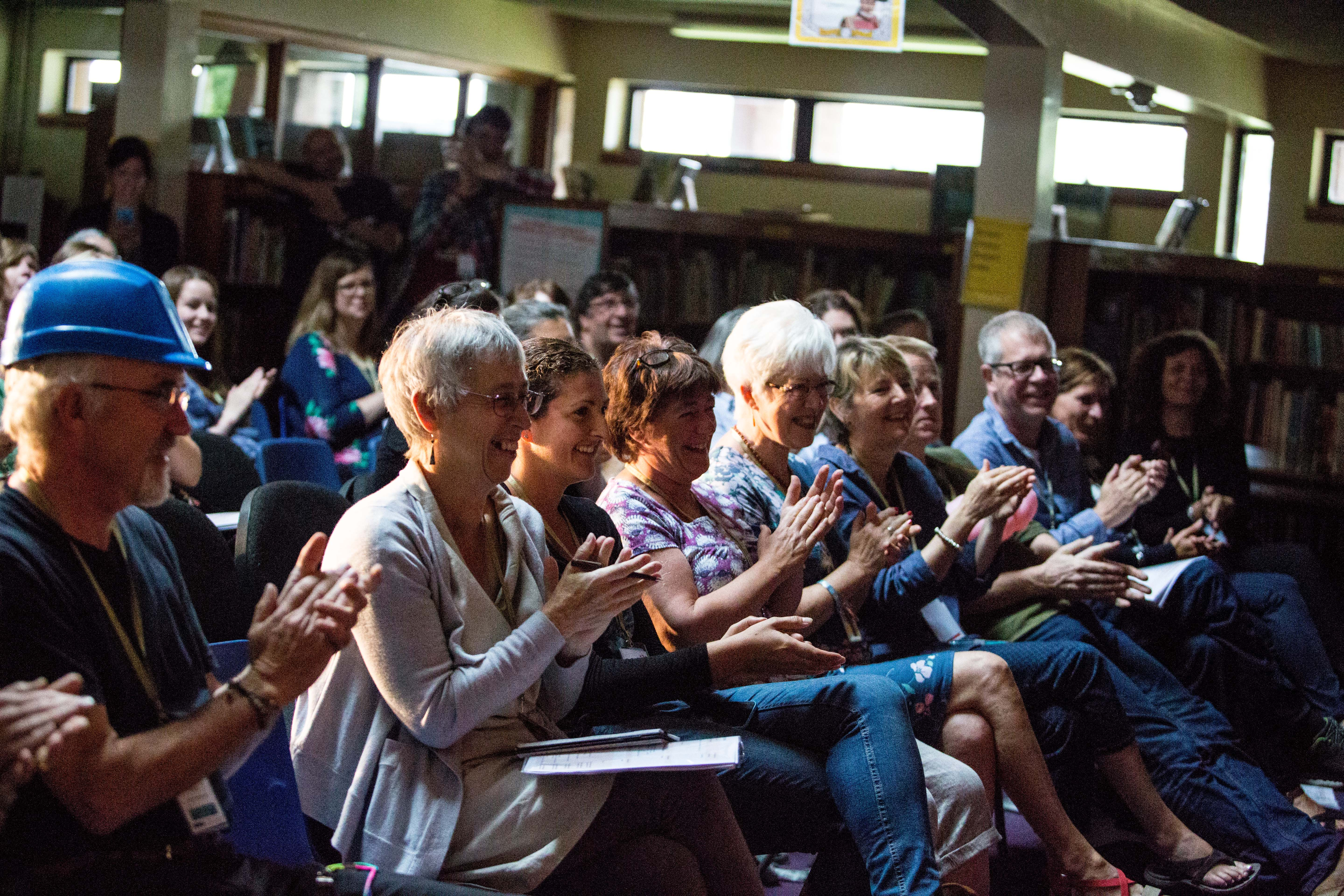 Seated audience members applaud at the National Rural Touring Forum Conference 2015.