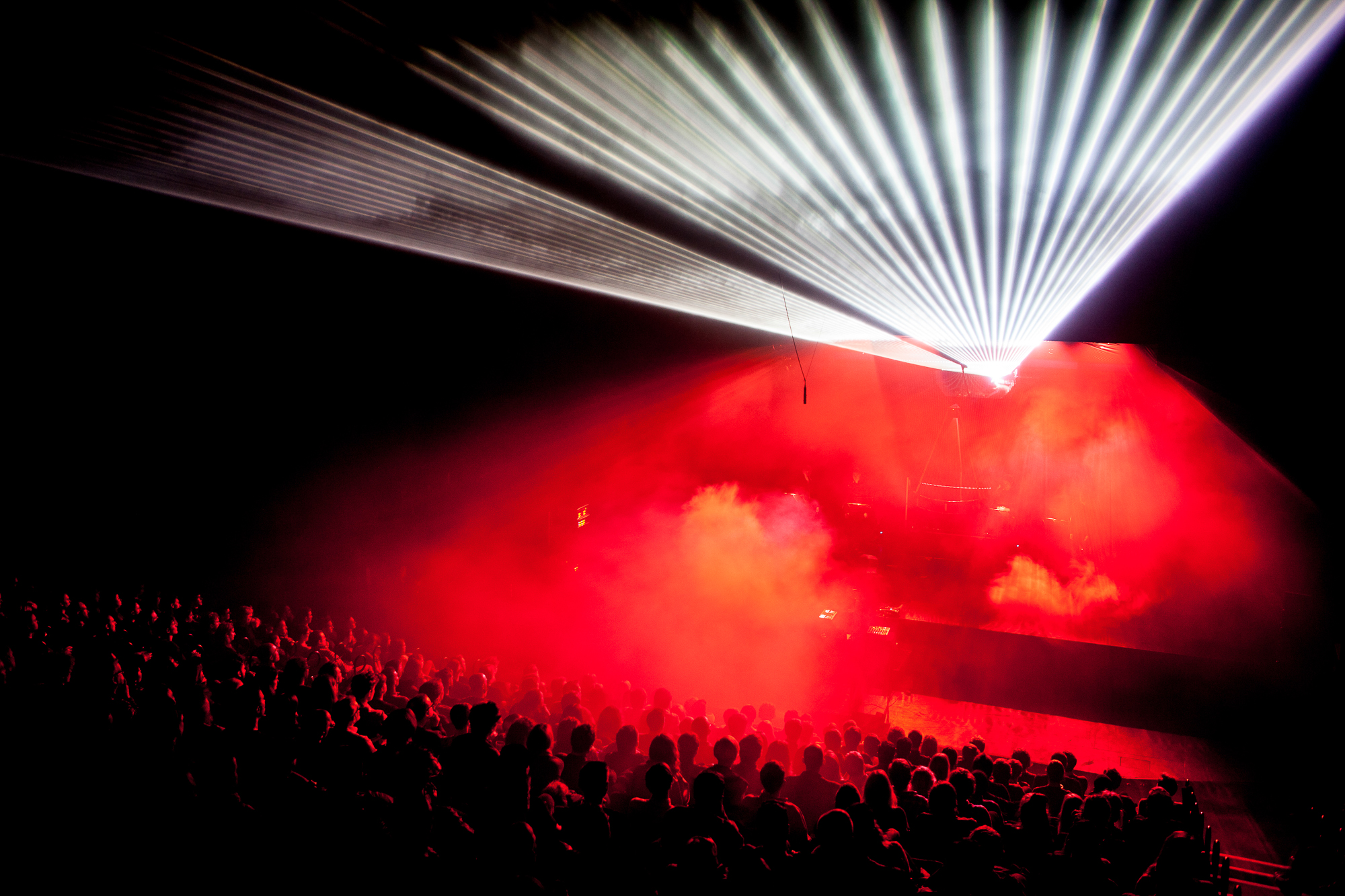 Audience looking at red lights on stage