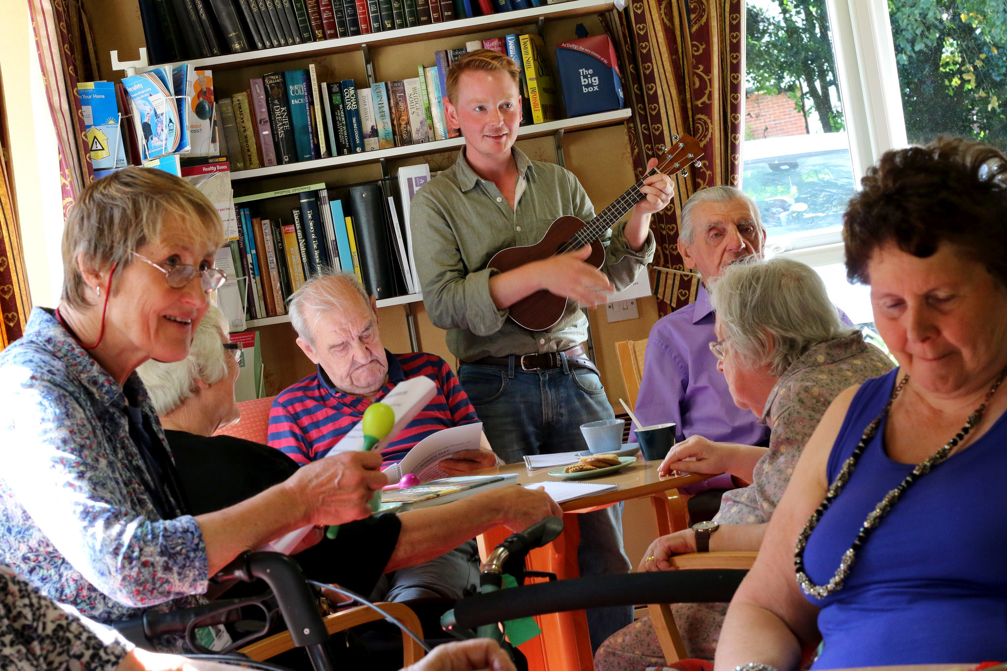 Members of the Royal Voluntary Service taking part in a singing and ukulele session with Sage Gateshead's Silver Lining programme and bait.