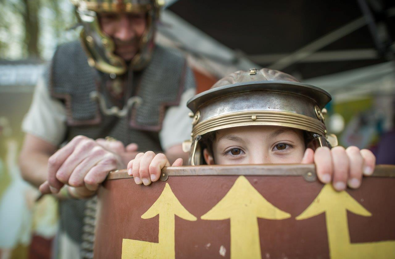 Children trying on Roman uniform from Royal Albert Memorial Museum & Art Gallery at Exeter Respect Festival