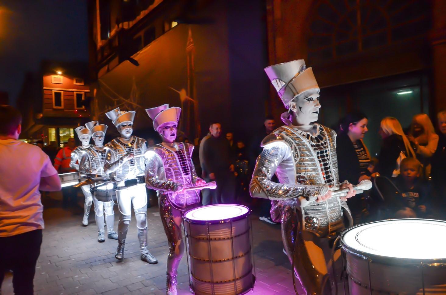 Drummers walking through Blackpool