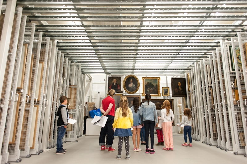 A group of children look at art in Towner Gallery